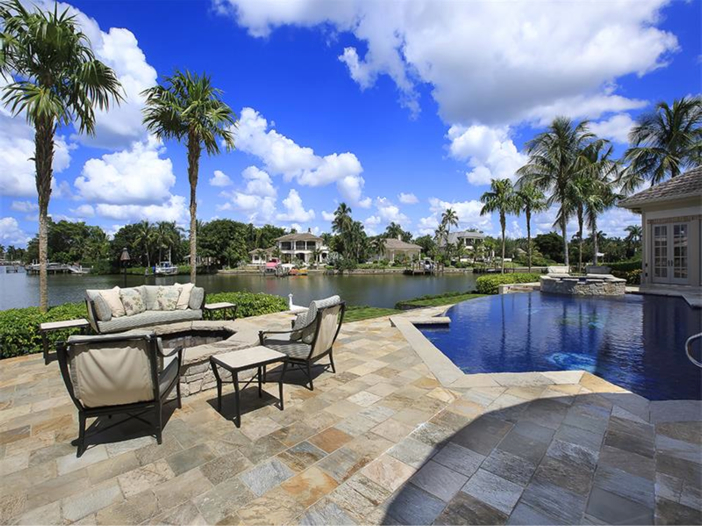 $5.1 Million Elegant European Mansion in Naples, Florida - Outdoor Sitting Area with Water Views