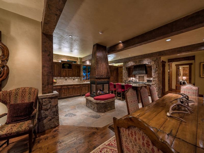 $10.9 Million Luxury Log Home in Beaver Creek, Colorado - Kitchen with Fireplace