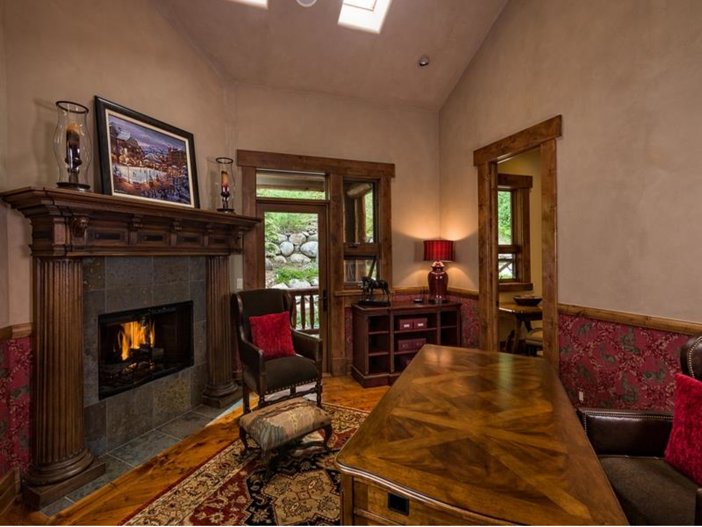 $10.9 Million Luxury Log Home in Beaver Creek, Colorado - Office with Fireplace