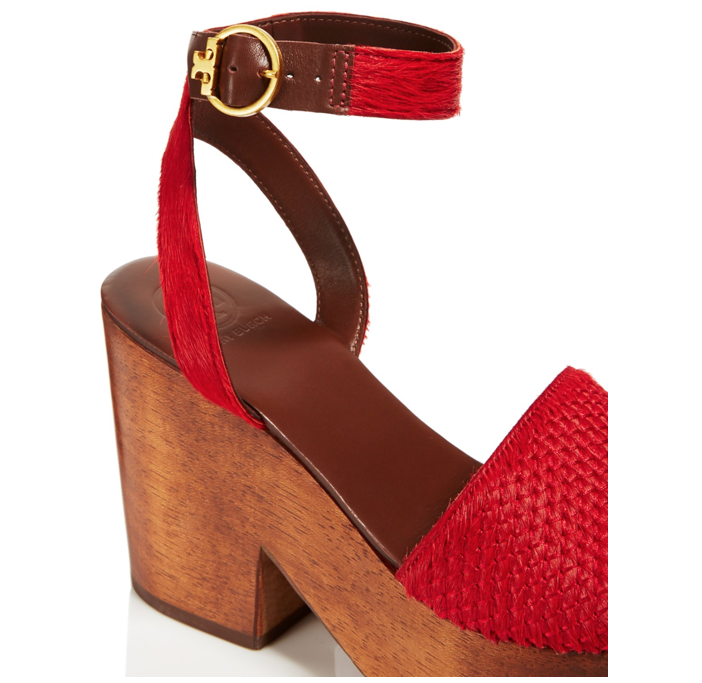"So if you want a tall shoe that barely feels like you are wearing a heel,  choose a shoe like the Tory Burch ""Camilla"" platform sandal."